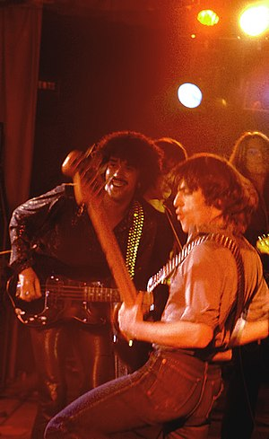 Thin Lizzy - Phil Lynott with Pete Briquette of The Boomtown Rats playing bass guitars with the Greedy Bastards in Dublin on 21 December 1978