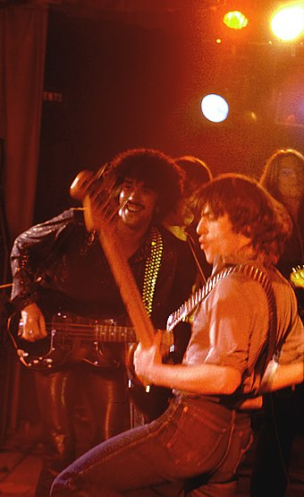 Phil Lynott with Pete Briquette of The Boomtown Rats playing bass guitars with the Greedy Bastards in Dublin on 21 December 1978 Phil & Pete.jpg