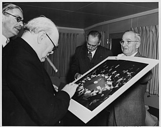 Churchill with Anthony Eden, Dean Acheson and Harry Truman, 5 January 1952. Photograph of President Truman giving British Prime Minister Winston Churchill a photograph taken at the 1945 Potsdam... - NARA - 199024.jpg