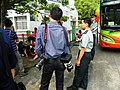 Photographer Talking with Master Sergeant in Waiting Bus 20121013.JPG