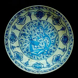 Islamic pottery - Plate with dragon. Persia, 17th century, inspired by 15th-century Chinese blue and white porcelain