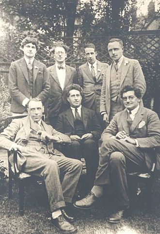 Edward Arthur Milne - Left to right, standing: Mark Gertler, Hewy Levy, Walter J. Turner, Edward Arthur Milne; sitting: Ralph Hodgson, J.W.N. Sullivan, S. S. Koteliansky. London, 1928