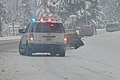 Police-car-snowy-road.jpg