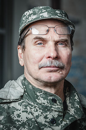 Portrait of Deputy Commander of the militia Fedor Berezin with the Donetsk Regional State Administration on background on june 21, 2014 in Donetsk. 002.jpg