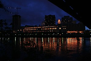 Minneapolis Post Office - Post office on the Mississippi River at night, seen from under the Hennepin Avenue Bridge