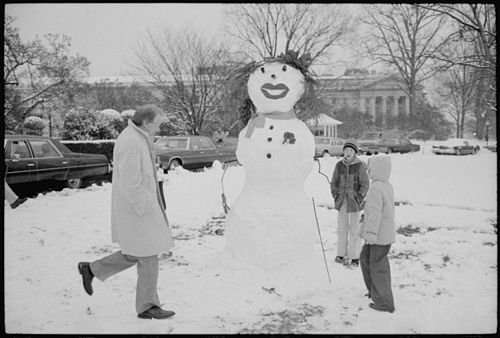 President Carter views snowman built by Amy Carter and her friends. - NARA - 177590.jpg