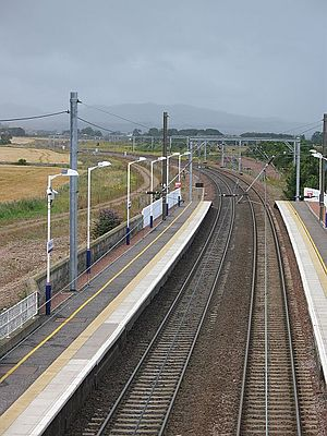 Prestonpans railway station - View along the tracks to a rainy Pentlands and the recent track deviation