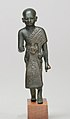 Priest in a leopard skin cloak with an inscription and Osiris on his skirt MET 26.7.1415 front.jpg