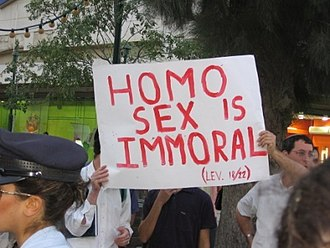 "Religious protestors at a pride parade in Jerusalem, with a sign that reads, ""Homo sex is immoral (Lev. 18/22)"". The association of homosexual sex with immorality or sinfulness is seen by many as a homophobic act. Protestors at a pride parade in Jerusalem with sign that reads, ""Homo sex is immoral (Lev. 18-22)"".jpg"