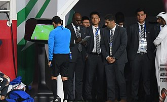 2019 AFC Asian Cup - Referee César Arturo Ramos reviewing a play using Video assistant referee during a semi-final match between Qatar and UAE.