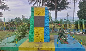 Lae - Monument at the old RSL building. Site marks the location when on 16 September 1943 Kenneth Eather from 25th Brigade raised the Australian flag following the defeat of the Japanese.