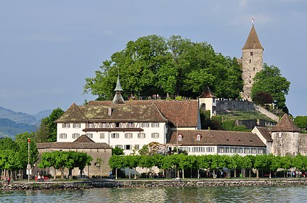Rapperswil harbour, Seedamm and wooden bridge; Einsiedlerhaus and parts of the Capuchin monastery's (to the right), the rose gardens and Technical University (HSR) (to the left), as seen from Lindenhof at the Rapperswil castle
