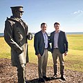 Rep Mike Gallagher with Andrew Hastie standing with statue of Sir David Stirling at Campbell Barracks in Western Australia on 10 August 2019.jpg
