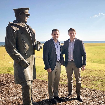 Mike Gallagher with Australian MP Andrew Hastie by a statue of Sir David Stirling, the founder of the Special Air Service, at Campbell Barracks in Western Australia in August 2019