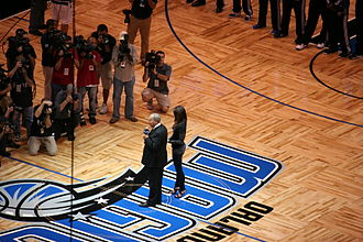 Amway Center - Magic owner Rich DeVos speaking to fans before the first Magic home game in the new arena. (Notice the parquet flooring; only the Boston Celtics currently utilize the same kind of flooring.)