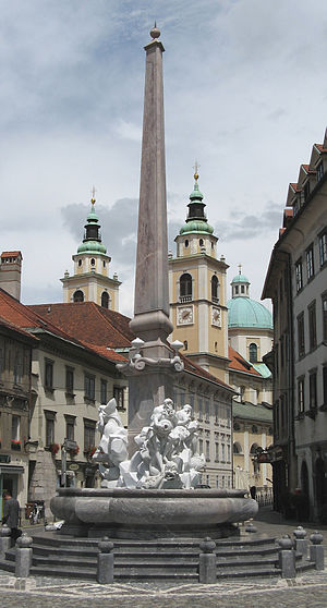 Francesco Robba - The Robba Fountain at Town Square in Ljubljana. In the background, Ljubljana Cathedral can be seen.