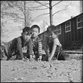 Rohwer Relocation Center, McGehee, Arkansas. If he's a boy in America he plays marbles, as these la . . . - NARA - 538906.jpg