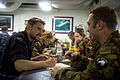 Royal New Zealand Navy Able Medic Finbar Marshall, left foreground, speaks with New Zealand Army engineers at a shipboard orientation aboard the amphibious dock landing ship USS Pearl Harbor (LSD 52) June 3 130603-N-WD757-082.jpg