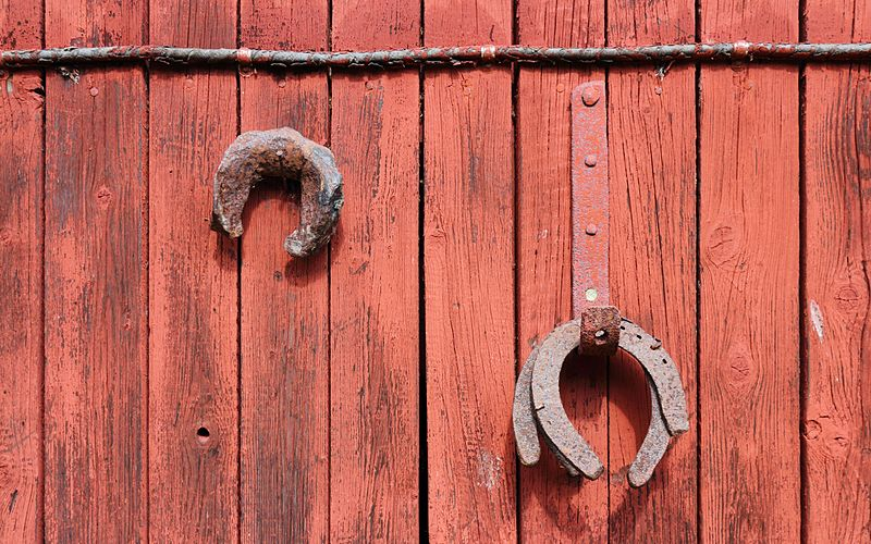 image of Rusty horseshoes on red painted wood 2012-08-05