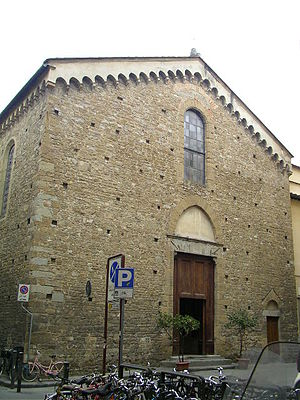 San Remigio, Florence - Exterior of San Remigio di Firenze showing the hanging arches along the roof line.