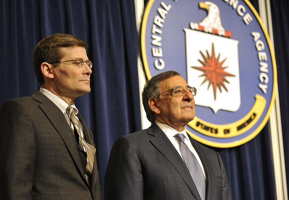 Secretary of Defense Leon E. Panetta stands with Michael Morell, acting director of the CIA, as a citation is read in Morell's homor on stage during one final visit to the CIA