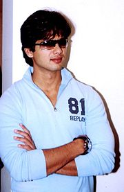 Shahid Kapoor, wearing sunglasses, looks away from the camera