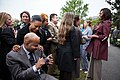 Sherman and Tammie Gillums look at their pictures with First Lady Michelle Obama, 2012.jpg