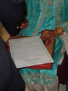 bride signing the marriage contract, Nikaah at a Pakistani wedding