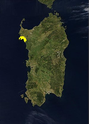 Algherese dialect - A satellite photo of the island of Sardinia with the location of the Algherese-speaking area being marked in yellow.