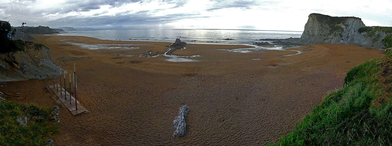 Panoramic of Arrietara (left) and Atxabiribil (right) beaches in Sopelana, Basque Country.