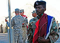 South African National Defense Force Pvt. David Hendricks, right, stands with his unit colors as U.S. Soldiers recover their national colors during a rehearsal for exercise Shared Accord 2013 in Port Elizabeth 130721-A-FP002-009.jpg