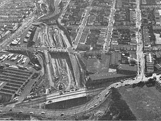 Balboa Park station - Freeway construction on the former SP right-of-way in 1964. Elkton Shops is at left.