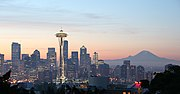 Visitors to Kerry Park on Queen Anne Hill can see the Space Needle, the Downtown Seattle skyline, and Mount Rainier (to the right).