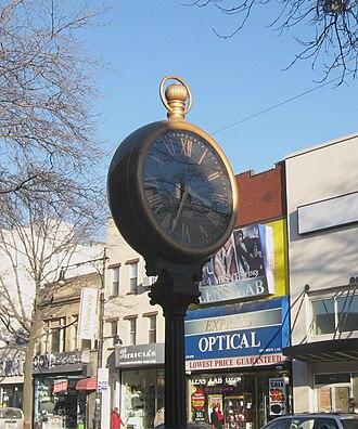 Steinway Street - Looking northeast at 30–78 Steinway Street clock