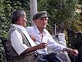Stereotypic Albanian men in Sarandë (7912534772).jpg
