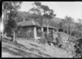 Stone house with pillars at the front of a deep verandah ATLIB 324305.png