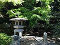 Stone lantern and pond in Miyajidake Shrine.JPG