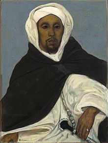 Thami El Glaoui in traditional tribal clothing with a dagger at his hip