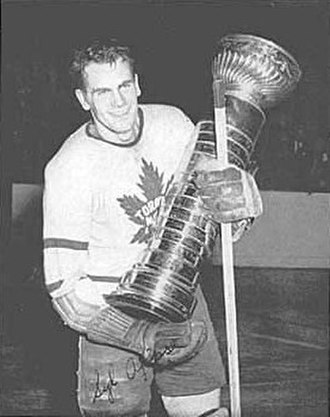 History of the National Hockey League (1942–67) - Syl Apps, with the Cup before it was redesigned, in the 1940s