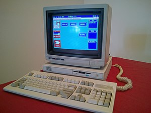 Tandy 1000 - A Tandy 1000 RL running DeskMate (optional mouse not shown)