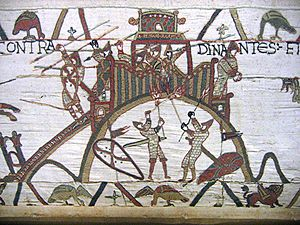 Breton–Norman War - Scene from Bayeux Tapestry (c.1066) showing Breton defenders within the castle of Dinan throwing down spears onto the Norman attackers, whilst some of the latter hold burning torches with which to burn down the wooden fortifications