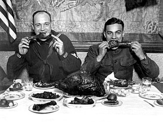 Turkey as food - US servicemen eating turkey at a Thanksgiving dinner after the end of World War I (1918)