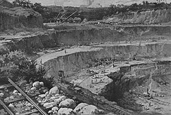 Illustration of a large, terraced excavation