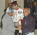 The President, Dr. A.P.J. Abdul Kalam presenting the Padma Shri Award – 2006 to a well known Manipuri Film Maker Shri Aribam Syam Sharma, in New Delhi on March 20, 2006.jpg