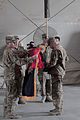 The commander and command sergeant major of the U.S. Army's 4th Brigade Combat Team (BCT), 101st Airborne Division (Air Assault) uncase the colors at Forward Operating Base Salerno in Khost province 130522-A-CW939-051.jpg