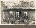 Torres Straits types (three men wearing head dresses sitting outside hut) Frank Hurley (24994993629).jpg
