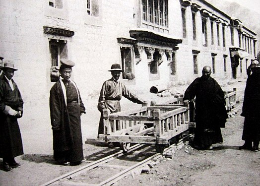 The Tibetan coin mint Drapshi Lekhung photographed by Frederick Williamson on August 31, 1933 the official Kunphel is on the extreme right. He was responsible for the modernization of the Tibetan National Mint. Trabshi Lekhung.jpg