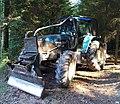 Tracteur New Holland TM125 avec équipement forestier (Rhône, France).jpg