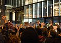 Trump election protest - crowd flips off the Trump Tower 2.jpg