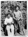 Two Yokut Indian men with grapes, Tule River Reservation near Porterville, California, ca.1900 (CHS-3807).jpg